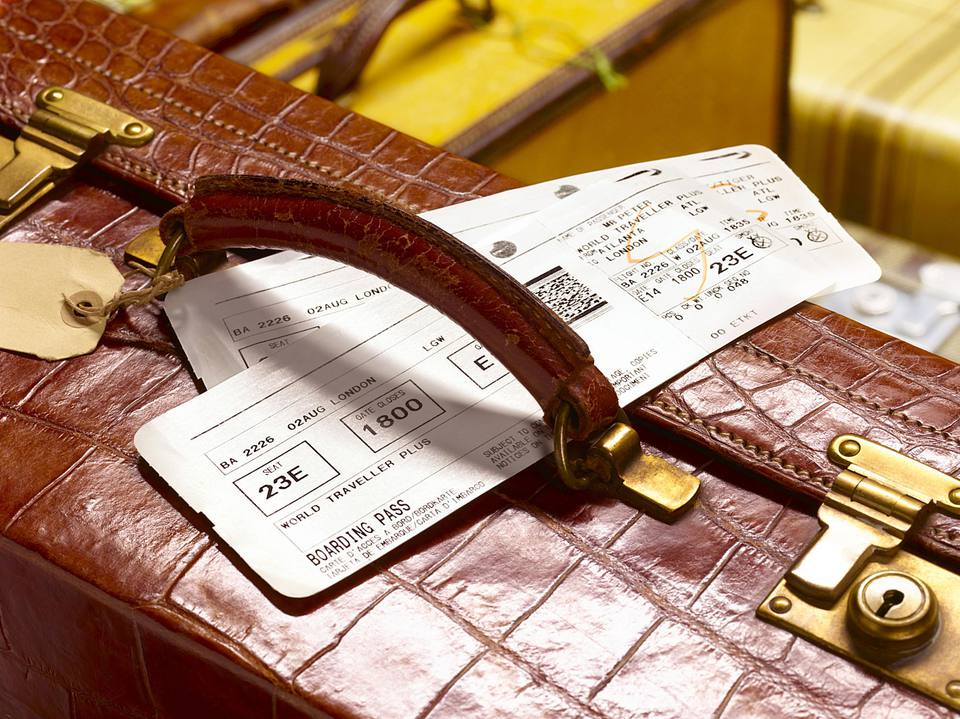 airline tickets on a suitcase