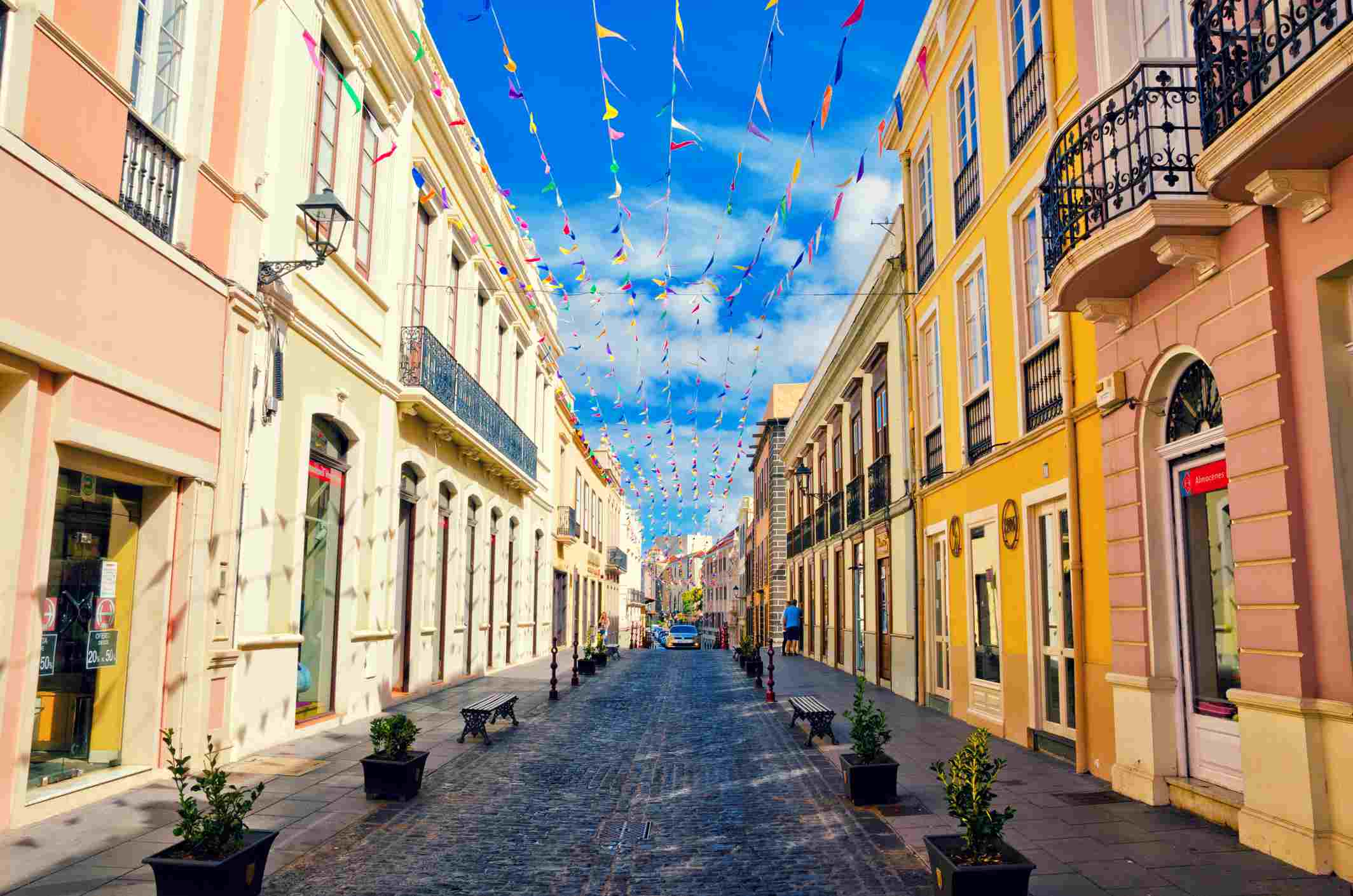 City street in La Orotava decorated with colorful flags