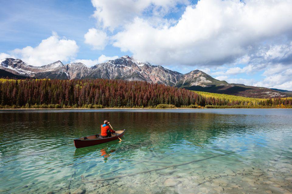 Man canoeing on lake, Jasper National Park, Canada
