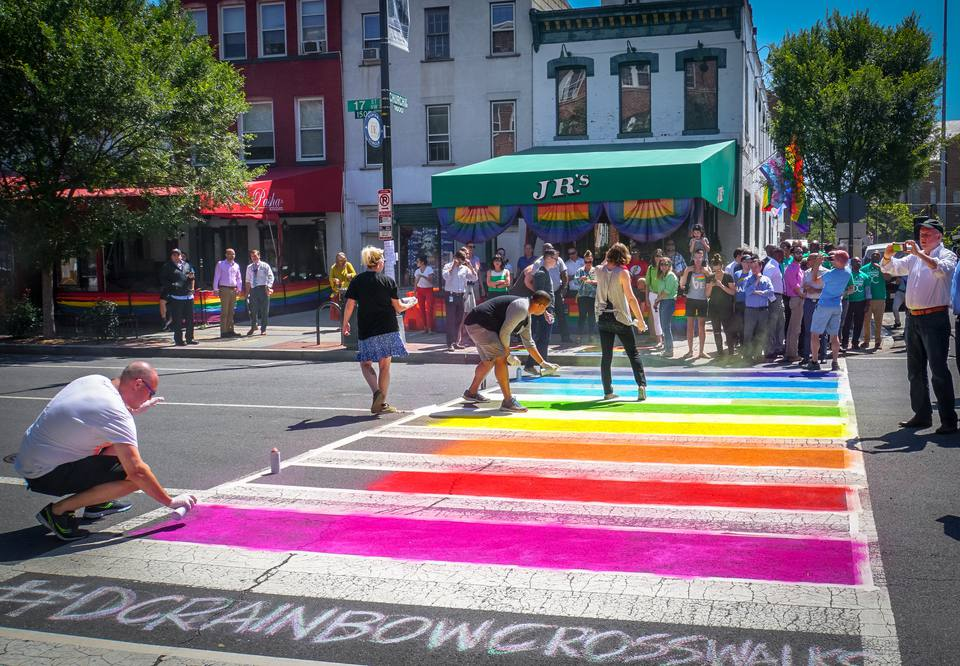 people painting a rainbow crosswalk in front of JR's Bar & Grill in Washington, D.C.
