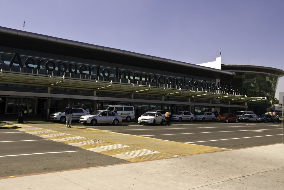 cars lined up in front of the Guadalajara international airport departures hall