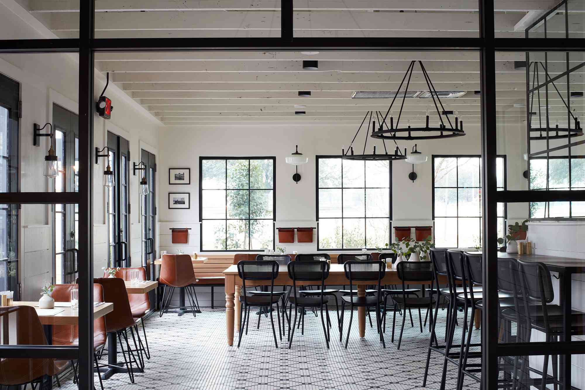 Empty black and white dining room at Magnolia Table in Waco