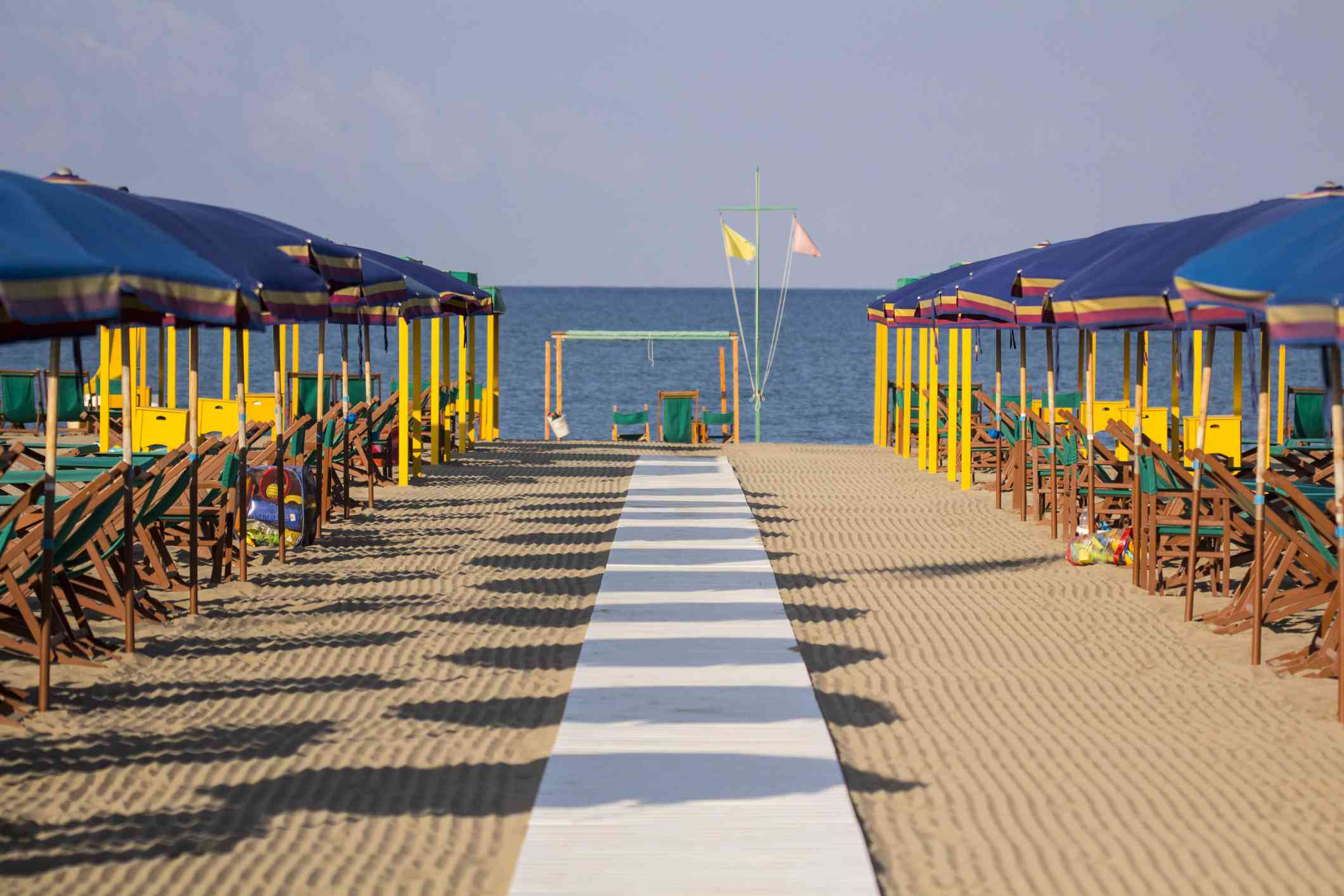 A beach club, complete with raked sand awaits guests at Forte dei Marmi