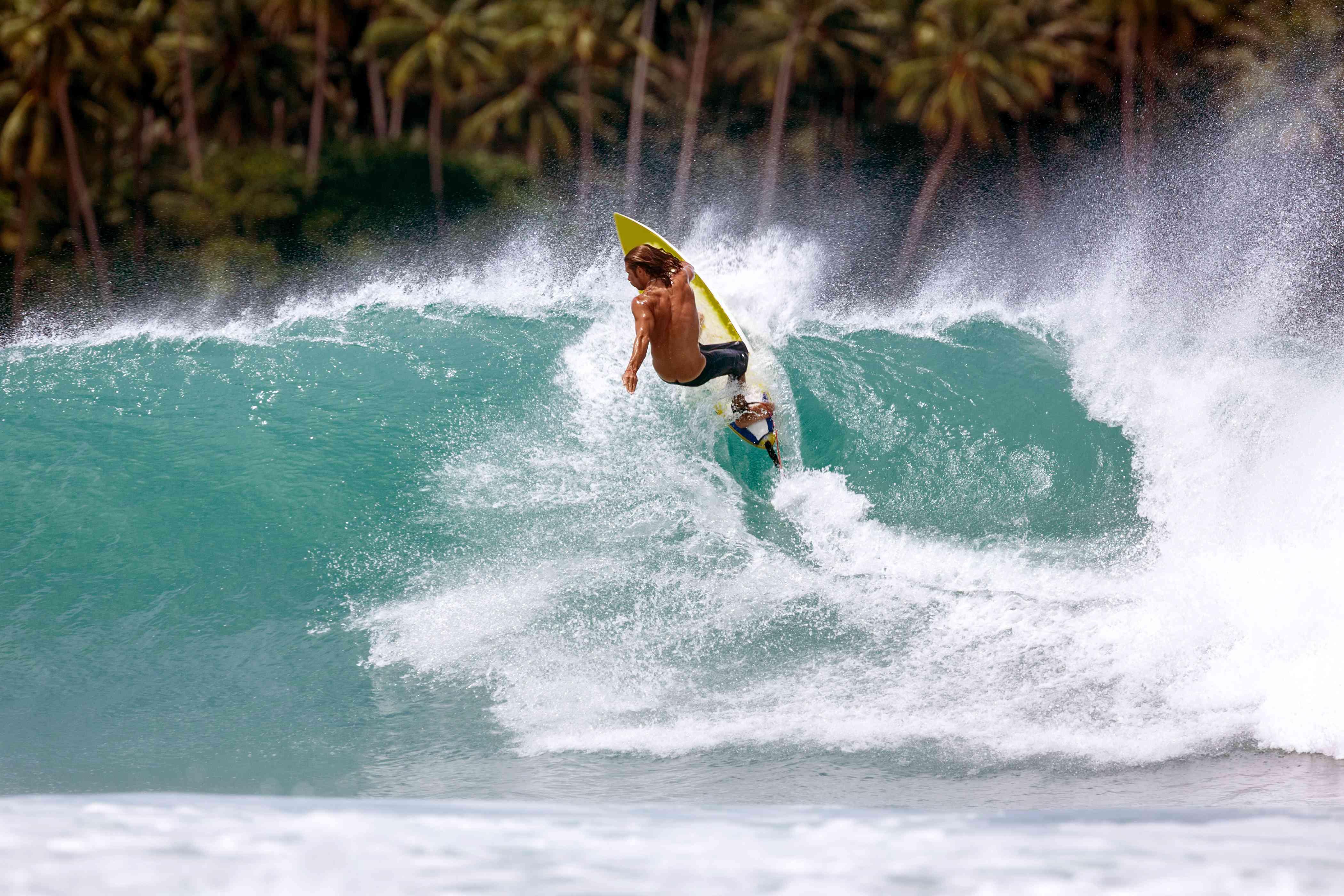 A surfer at Nias Island in Sumatra