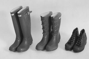 three different pairs and styles of waterproof boots