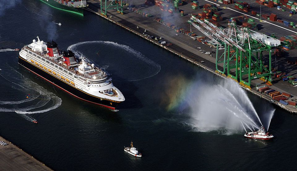 In this handout from Disney Cruise Line, surrounded by Los Angeles Fire and Coast Guard boats, the cruise ship 'Disney Magic', a 2,700 passenger ship, sails out for its first of 12 consecutive cruise vacations on May 28, 2005 from the Port of Los Angeles in San Pedro, California. This is the first time a Disney Cruise Line ship sails from the state other than Florida. The cruise line will bring passengers to the Mexican Riviera.