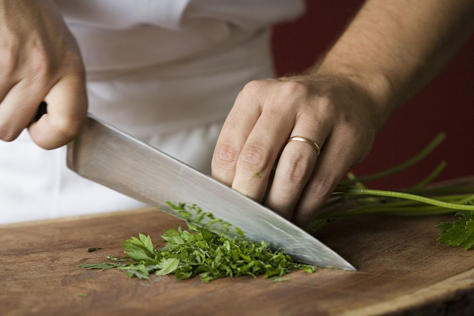 A chef chopping cilantro