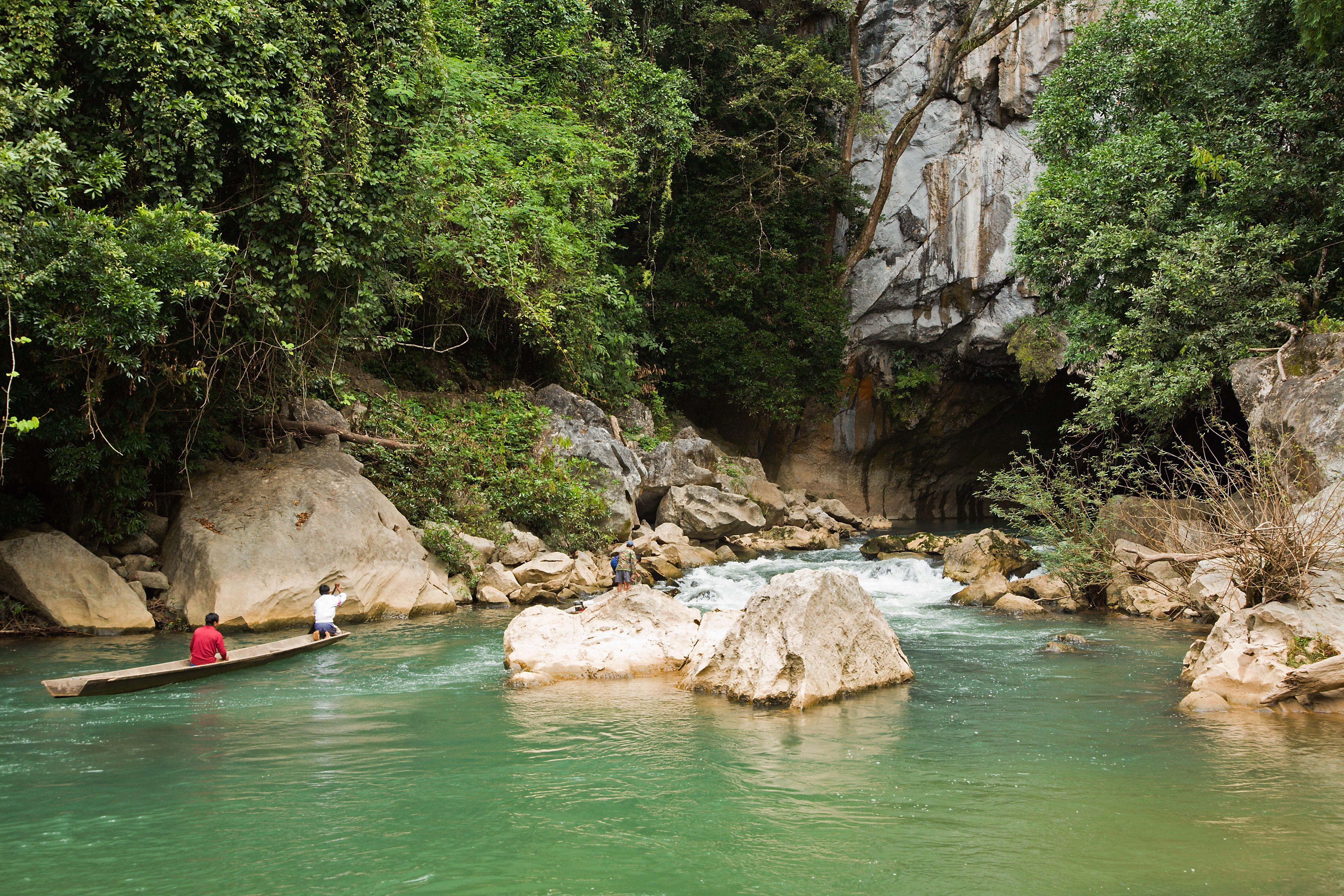 Boats before entrance to Tham Kong Lo cave near Ban Khoun Kham.