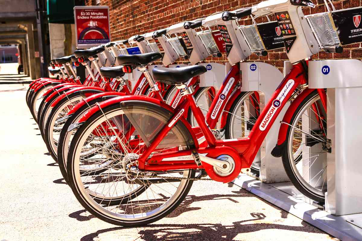 A row of red electric bike share bikes in Madison, Wisconsin.