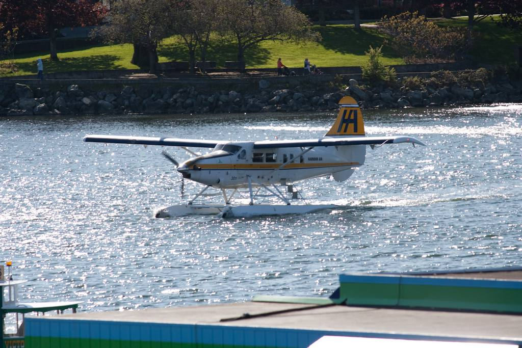 Harbour Air seaplane landing on the water.