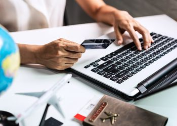 Midsection Of Woman Doing Online Shopping Over Laptop