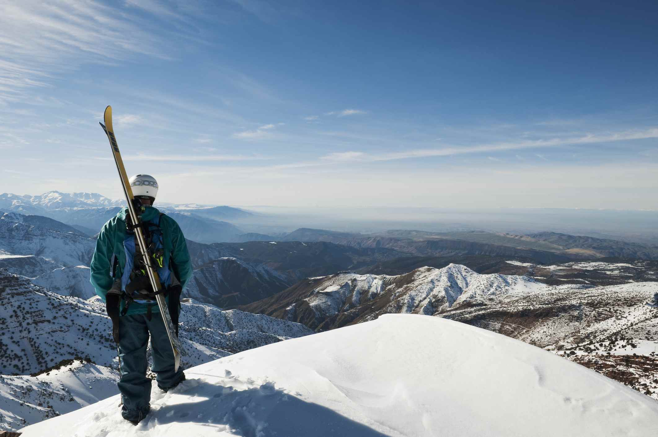 Skier at the top of a peak in the Atlas Mountains