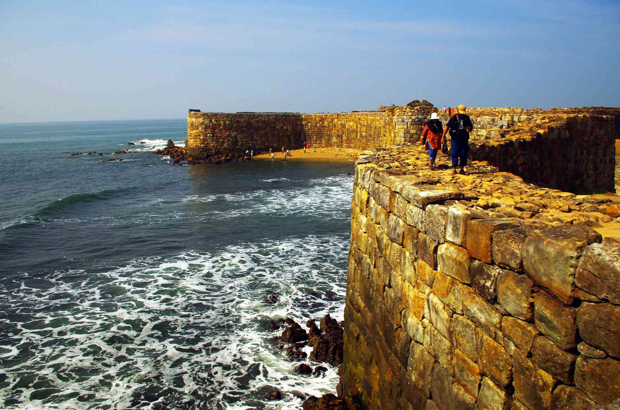Tourists walking on walls of Sindhudurg fort at Maharastra.