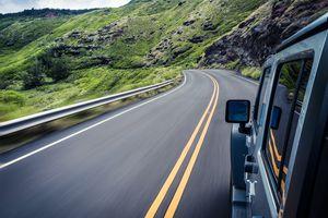 Car traveling along winding road, Maui, Hawaii, America, USA