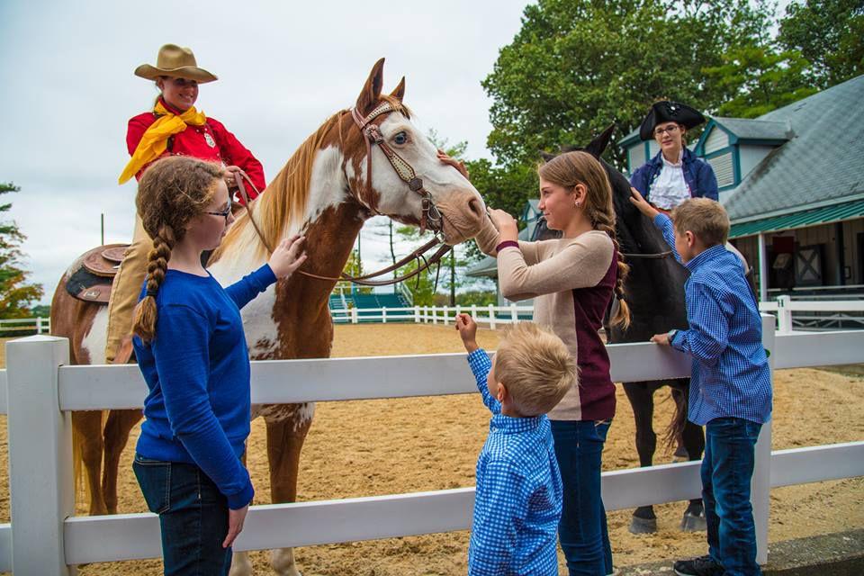 Kids petting horses at the Kentucky Horse Park