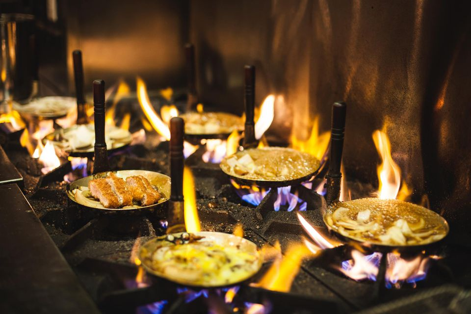 Food on a gas stove with flames