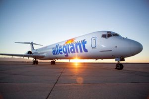 Allegiant Air plane backlit by the sunset