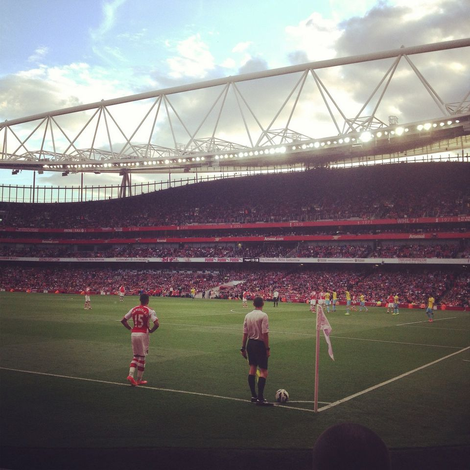 Pitch-level view of a match between Arsenal and Crystal Palace at Emirates Stadium
