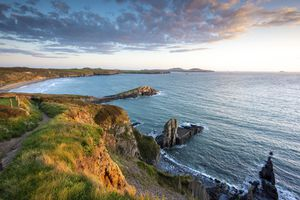 The cliffs above Whitesands beach on the Pembrokeshire coast path near St Davids at sunset