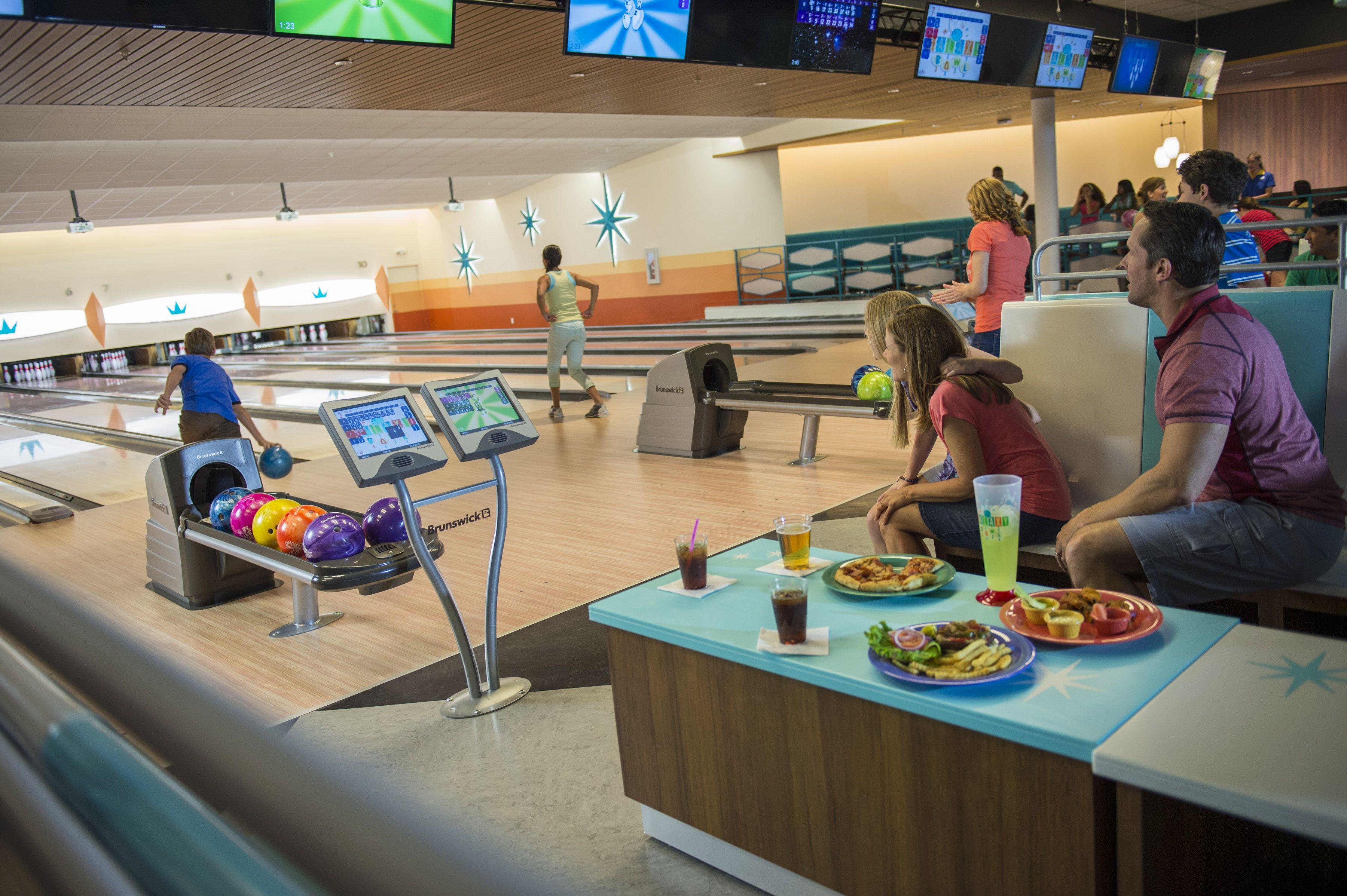 Family enjoying Universal Orlando's Cabana Bay Galaxy Bowling.
