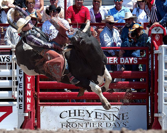 Corey Granger competes in the bull riding event at the 116th Cheyenne Frontier Days rodeo in Cheyenne, Wyo