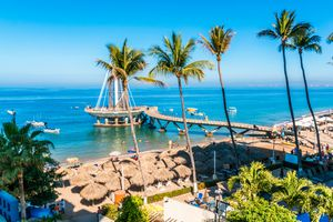Playa Los Muertos Pier and beach, Puerto Vallarta, comes alive with activity by locals and tourists