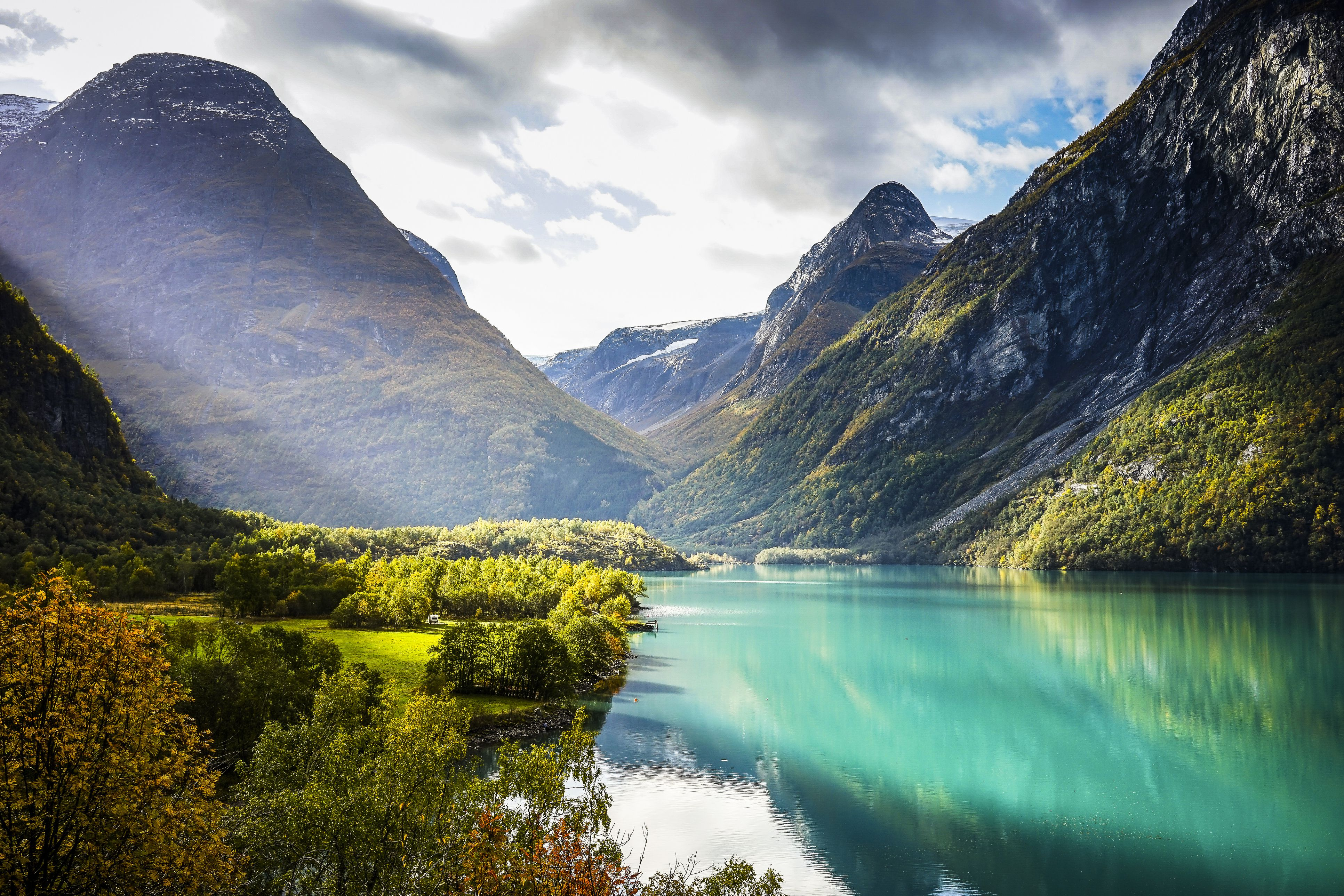 Clouds and sun beams over Geiranger fjord