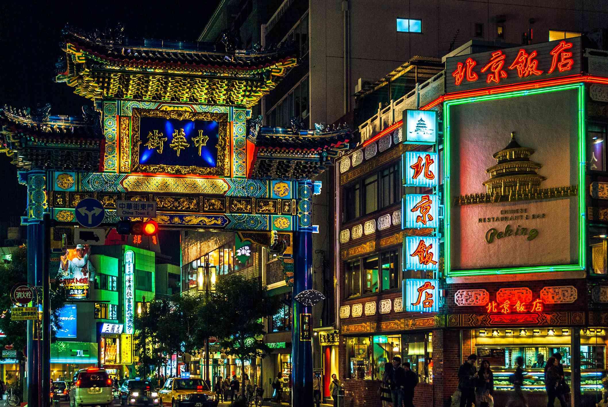 Illuminated gate to yokohama chinatown at night