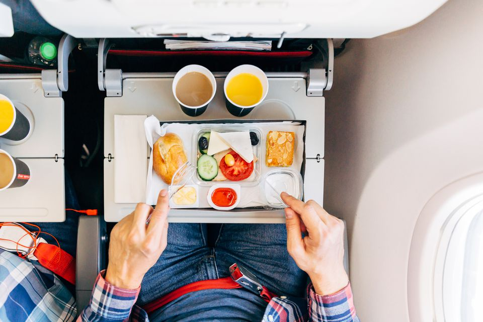 Eating airplane food during a flight, personal perspective directly above view
