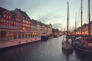 Nyhavn in Copenhagen, Denmark at dusk.