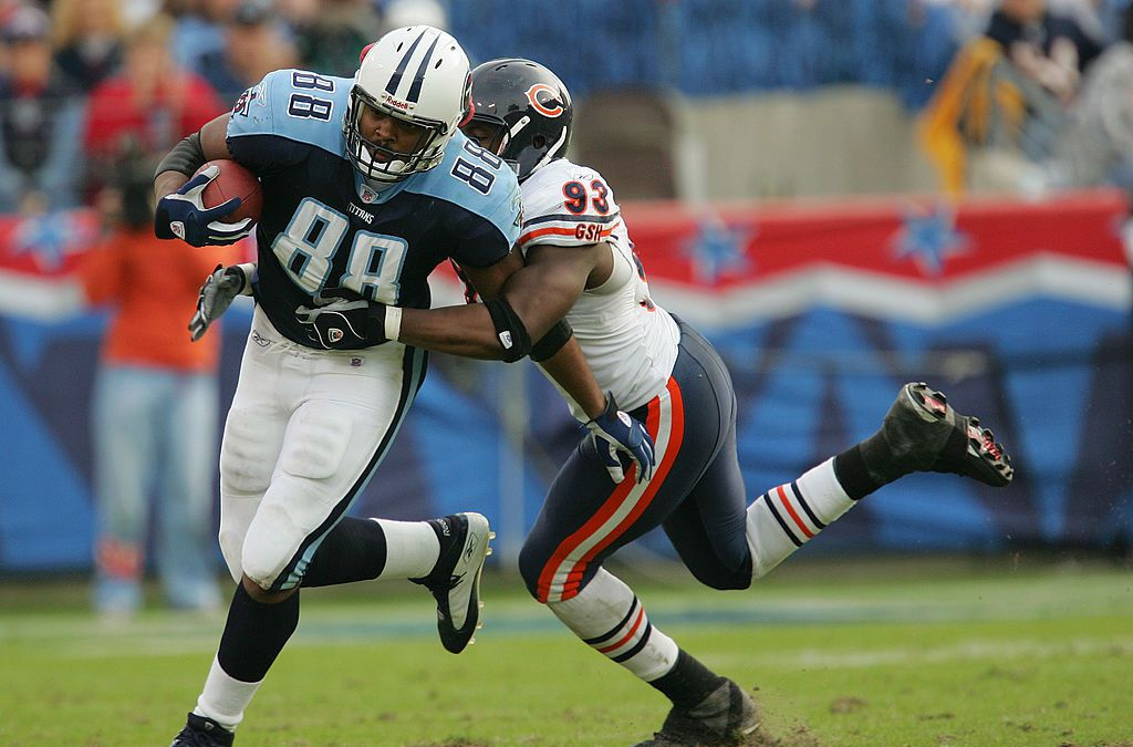 A Chicago Bear beginning to tackle a Tennessee Titans holding a football