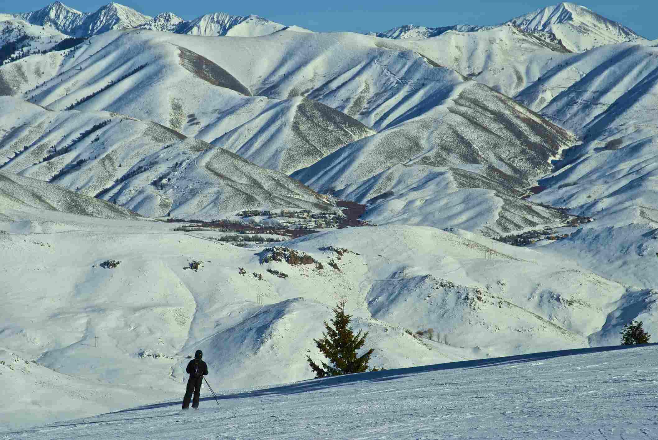 A skier skis in the Sawtooth Mountain range