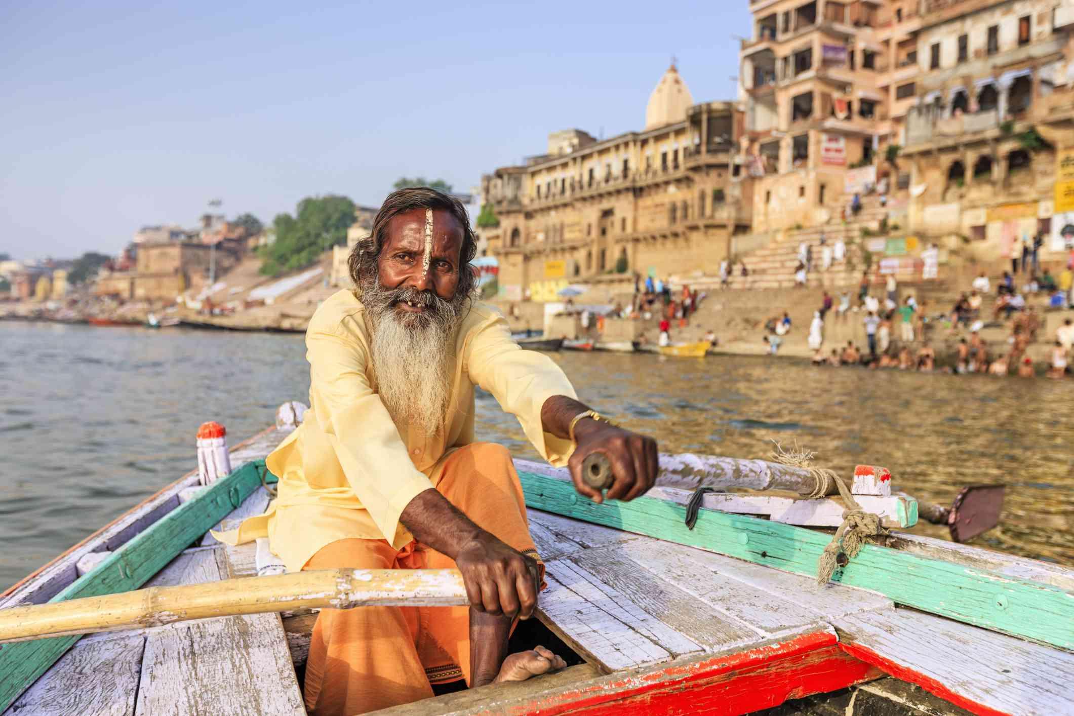 Varanasi, rowing a boat.