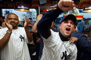 Yankees' fans cheer on their team throughout New York City