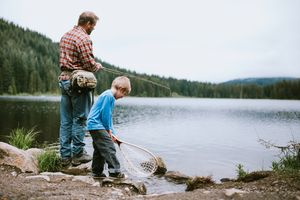 Father Fly Fishing With Son