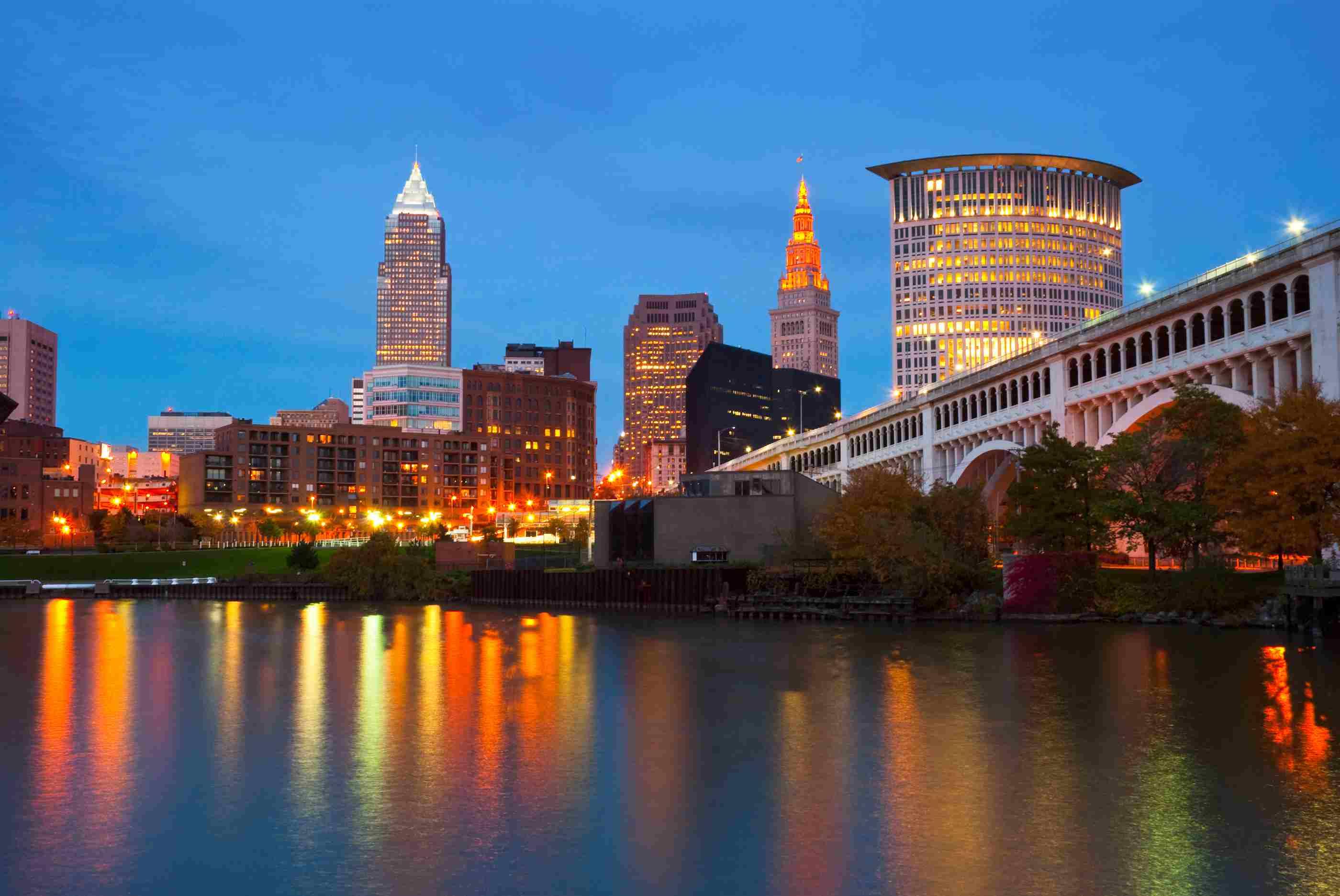 Cleveland skyline, river, and bridge at dusk