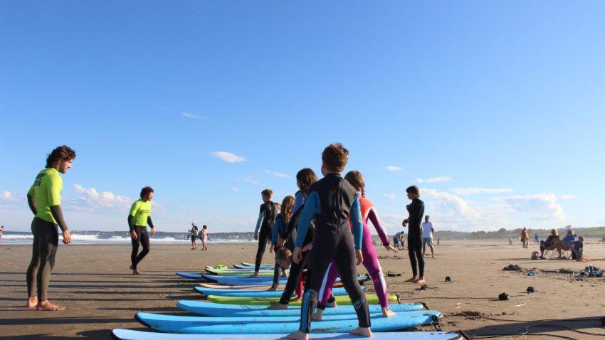 Liquid Dreams Surf Shop teaching kids how to surf