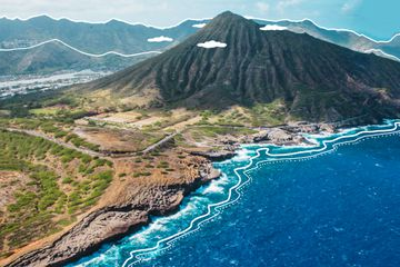 Aerial view of the Oahu landscape with drawings emphasizing the lines and illustrated clouds