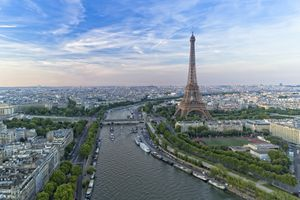 Aerial view of Paris and the Seine River with Eiffel tower during sunset