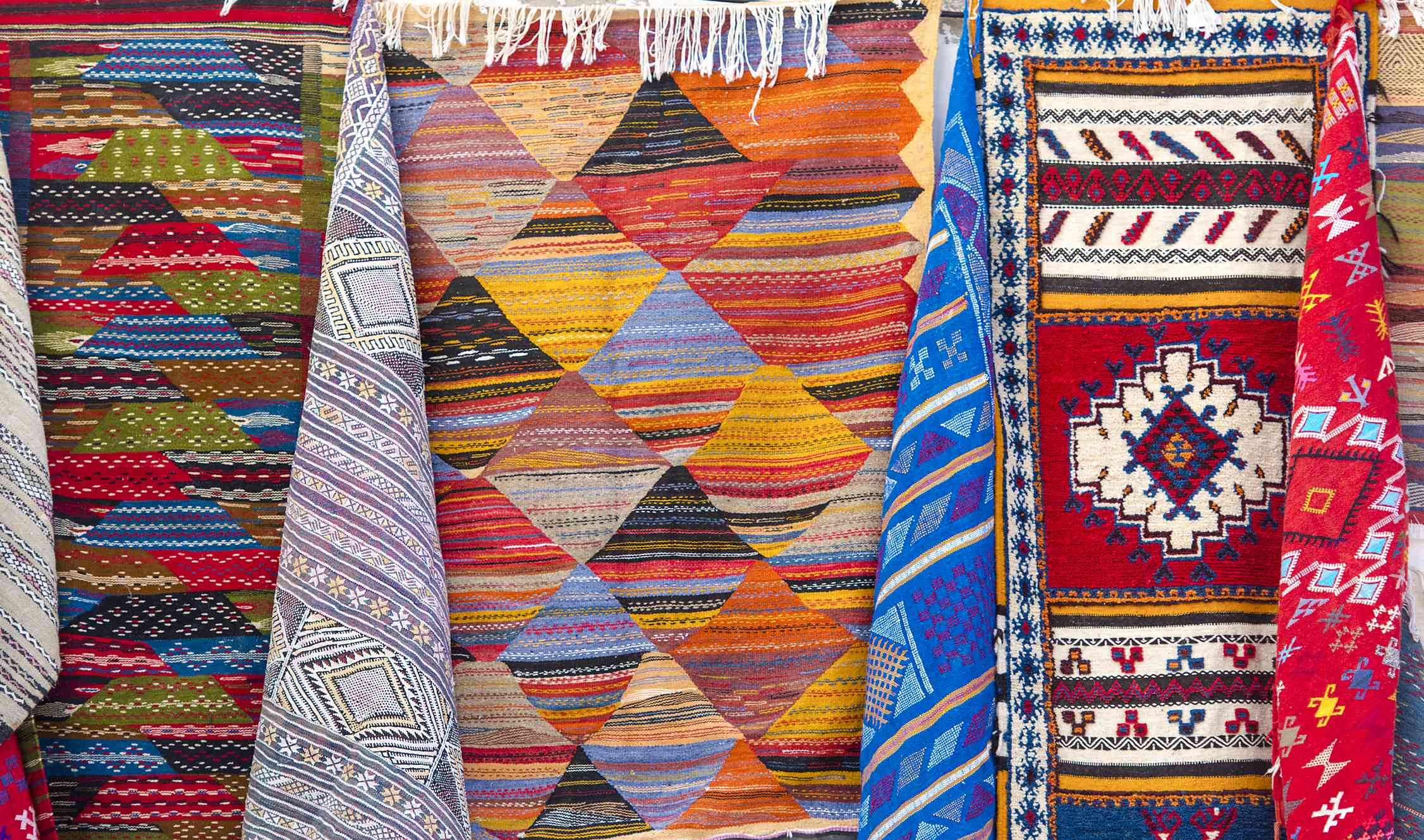 Traditional Moroccan Souvenirs and Carpets at a Market in Medina District