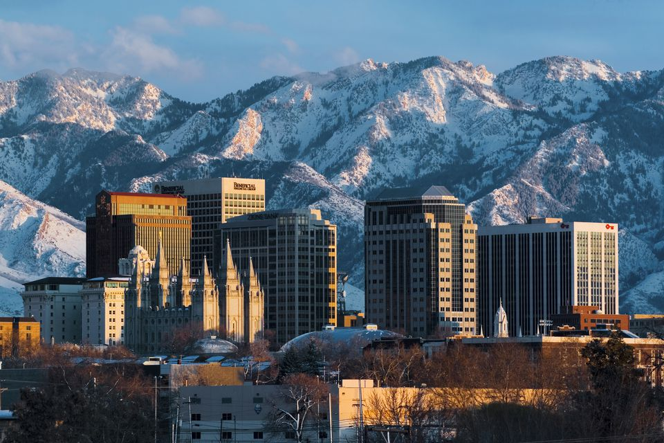 Winter scene of the downtown skyline with the Mormon Salt Lake Temple, backed by the snowcapped Wasatch Mountains, Salt Lake City, Utah, USA