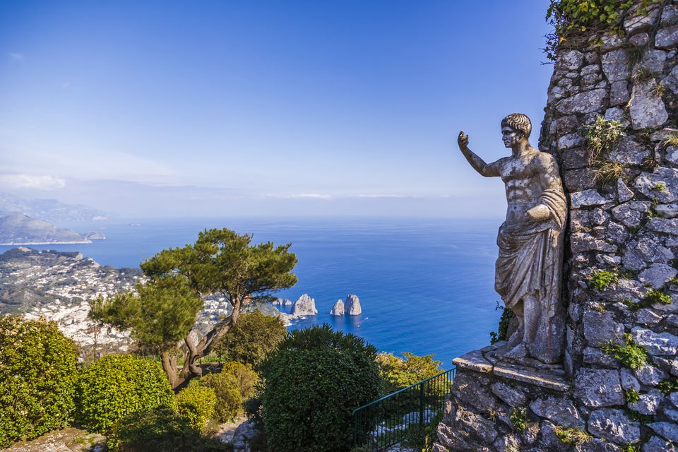 Statue of Tiberius in Capri island with a view of Faraglioni rocks, Italy