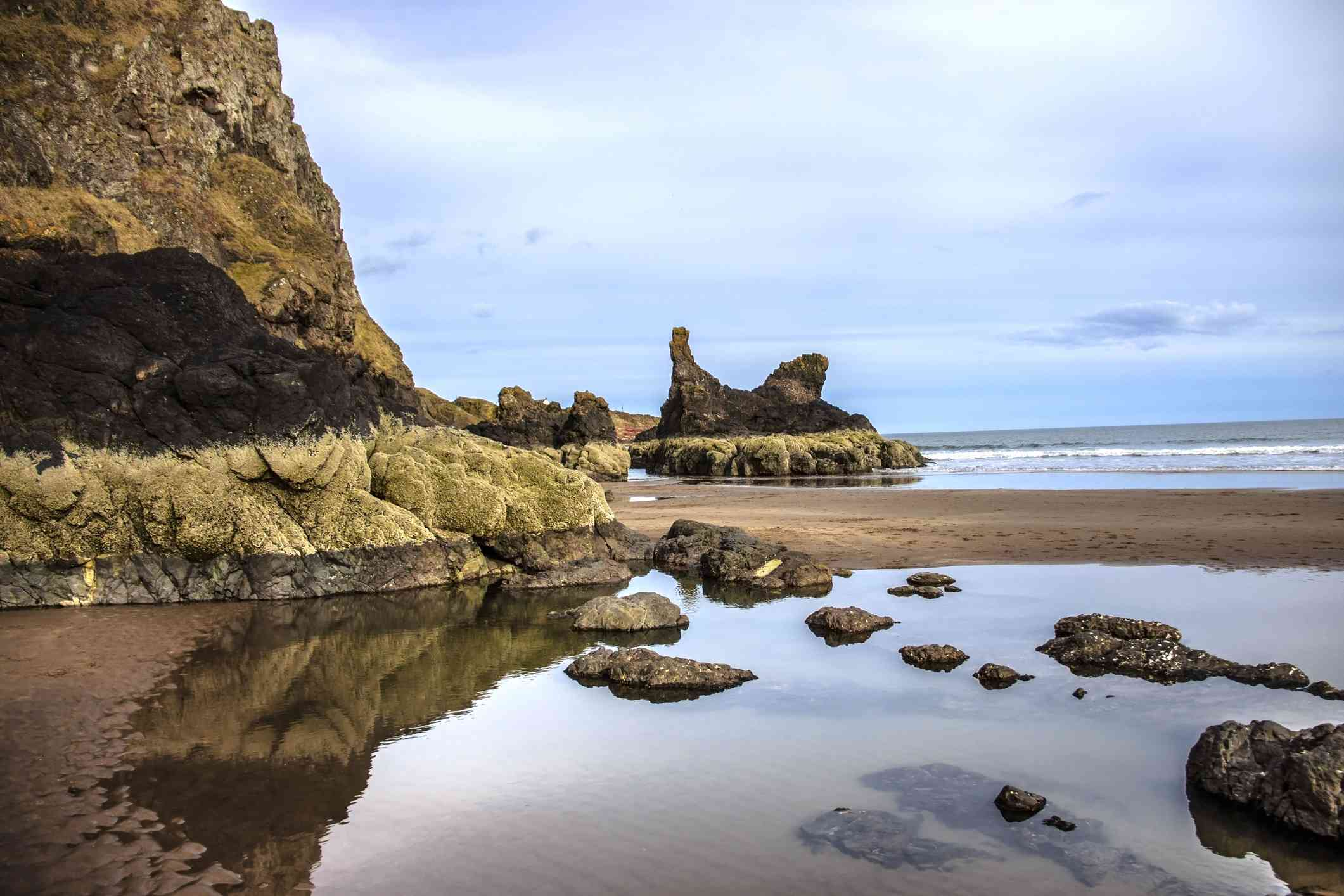 St Cyrus Beach in Scotland with mossy rock formations