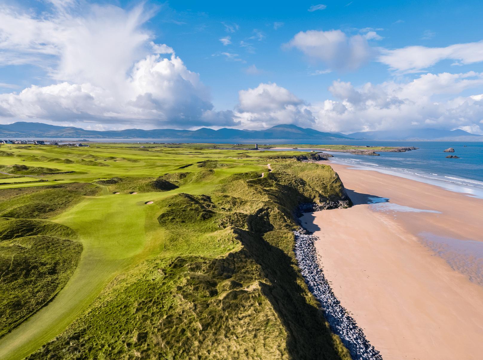 jagged green golf course along beach