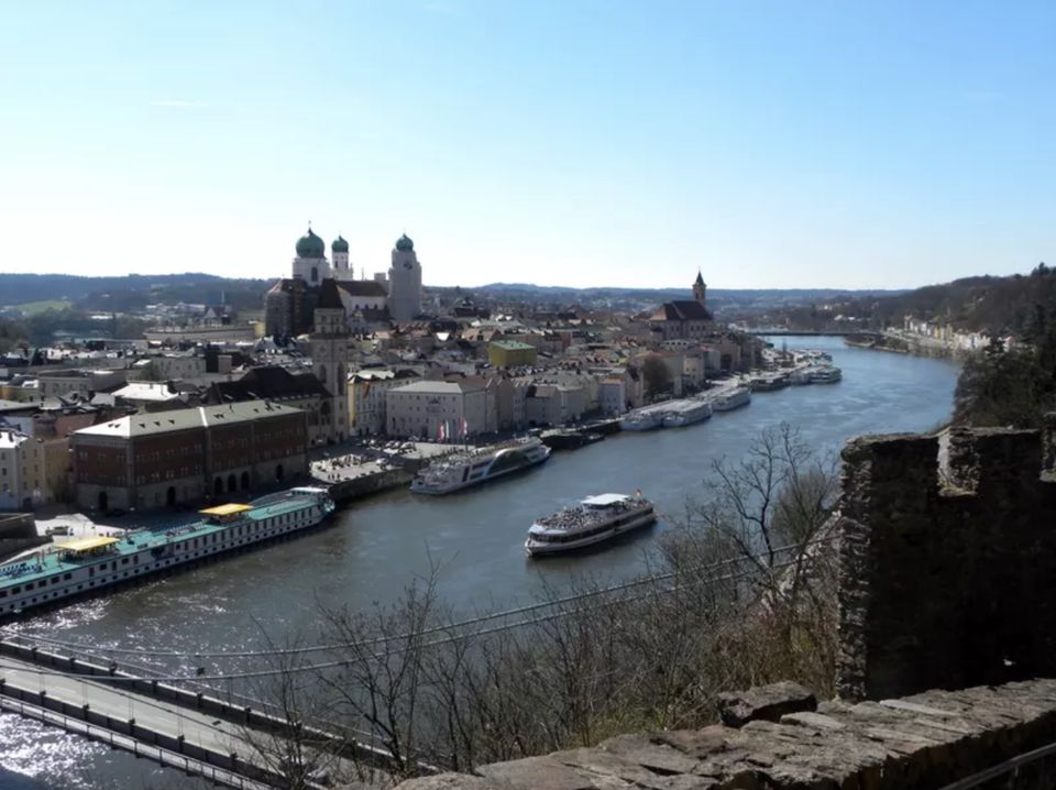 A river cruise ship passes through Passau, Germany