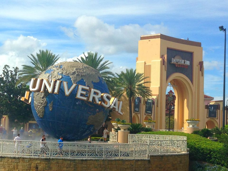 The iconic Universal globe logo statue and entrance gates at Universal Studios, Orlando