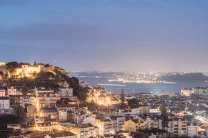 cityscape of lisbon lit up at night