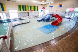 Kiddie City water play area indoors at Huck's Harbor