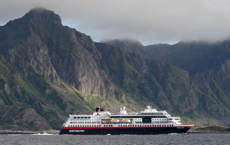 The Hurtigruten MS Midnatsol underway along the mountains of the Norwegian coast