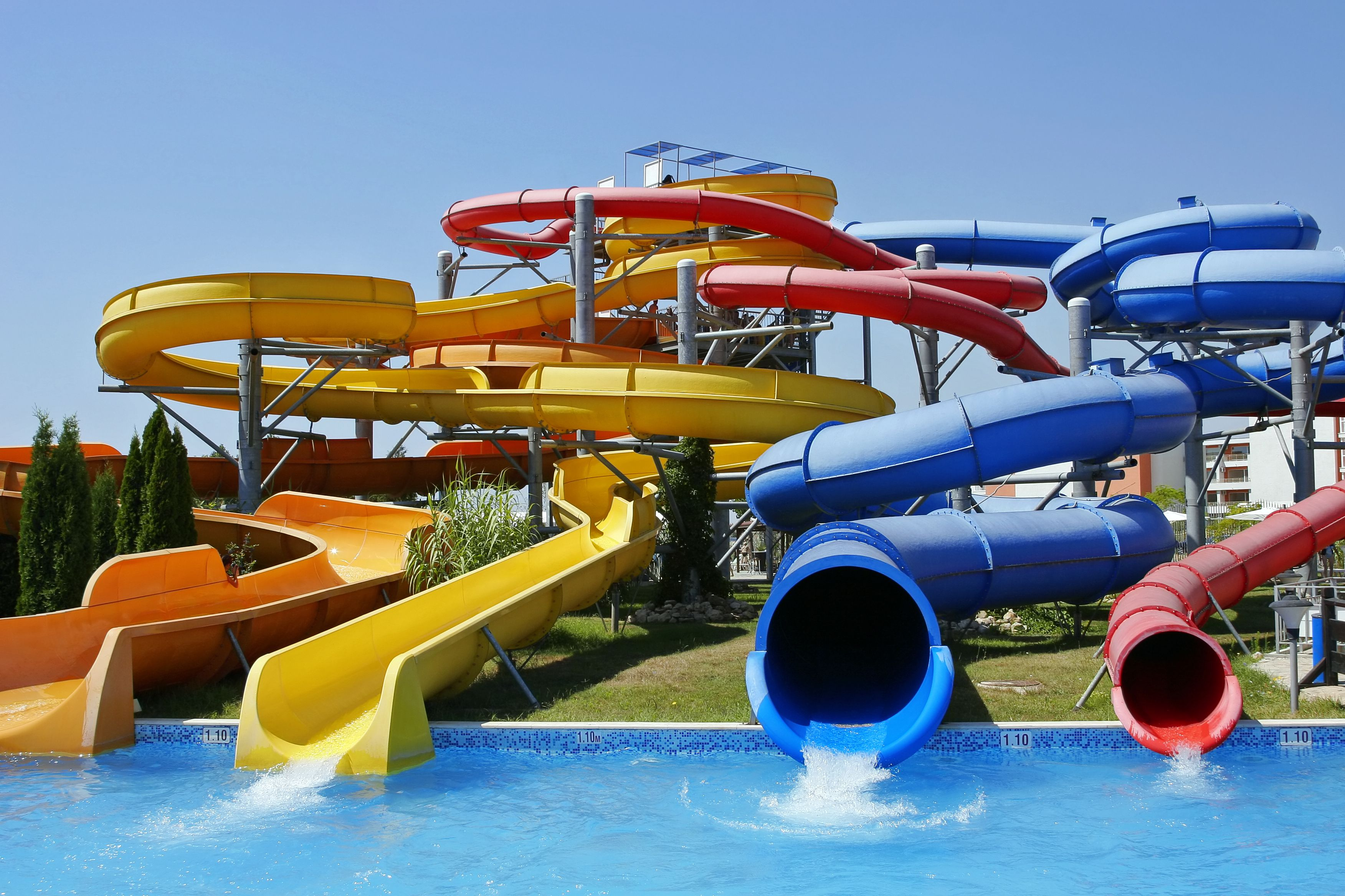 View of four different water park tubes on a clear day